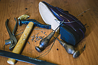 Shoemaker's tools and a new leather shoe - KIJF000200