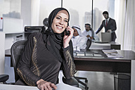 Middle Eastern businesswoman in office talking on the phone - ZEF008580