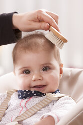 Portrait of happy baby girl brushed by her mother - DSF000617