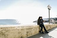 Spain, Tarragona, city break, young couple talking - JRFF000469