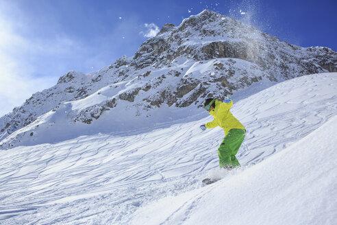 A snowboarder, snowboarding in Alps in Lech, Austria - VTF000512