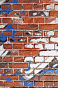 Old brick wall with remains of graffiti - GWF004636