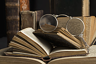 Lorgnette on stack of antique books - CRF002740