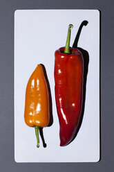 Two bell peppers on white board - MN000152