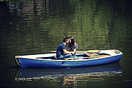 Lovers in rowing boat on water - PAF001560
