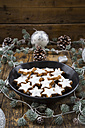 Cinnamon stars in bowl and christmas decoration - LVF004593