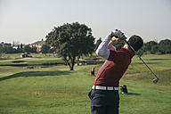 Golfer playing golf in a golf course - ABZF000239
