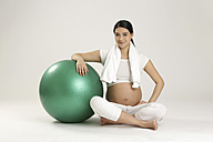 Smiling pregnant woman with fitness ball - SHKF000510