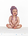 Portrait of happy naked baby girl wearing woolly hat - WWF003932