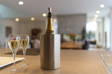 Champagne bottle in a cooler and two glasses of Champagne - LAF001617