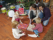 Family unwrapping Christmas presents - RHF001368