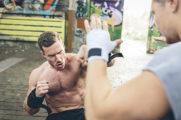 Two young men having a boxing workout - MADF000848