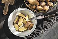 Enamel bowl of sliced raw potatoes - DEGF000682