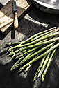 Green asparagus on dark wood - DEGF000685