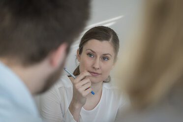 Woman looking at colleague - PAF001576
