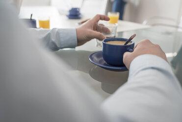 Man having a coffee break in office - PAF001594