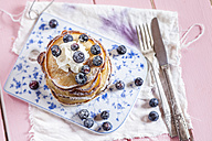Stack of American pancakes with whipped cream and blueberries - SBDF002707