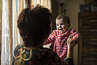 Grandmother playing with her little grandson at home - JASF000535