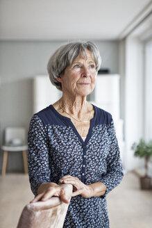Portrait of pensive senior woman at home - RBF004134