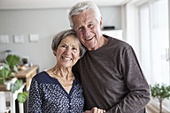 Portrait of happy senior couple at home - RBF004137