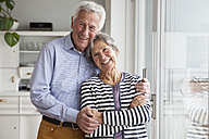 Portrait of happy senior couple at home - RBF004149