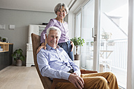Portrait of relaxed senior couple at home - RBF004164