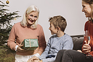 Grandson receiving gift from his grandmother on Christmas - MFF002764
