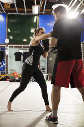 Female boxer sparring with coach - ZEDF000060