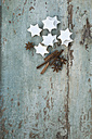 Cinnamon stars, cinnamon sticks and star anise on wood - ASF005863