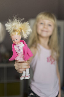 Little girl showing doll - JPF000119