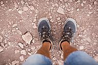 Chile, San Pedro de Atacama, Valley of the Moon, man's feet in the desert - MAUF000296