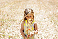 Portrait of little girl with bunch of flowers on a meadow - VABF000308