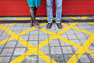 Legs of couple standing in a forbidden zone - VABF000311