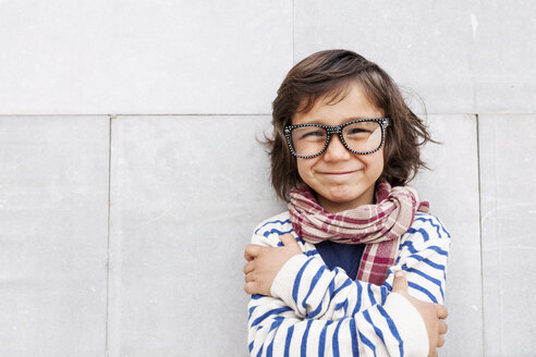 Portrait of grinning little boy wearing scarf and oversized glasses - VABF000320