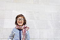 Portrait of laughing little boy wearing scarf and oversized glasses - VABF000323