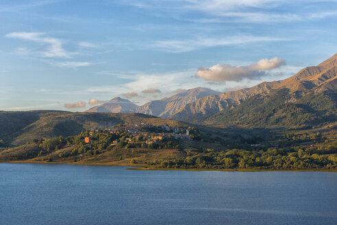 Italy, Abruzzo, Gran Sasso e Monti della Laga National Park, Lake Campotosto and town Campotosto at sunset - LOMF000238