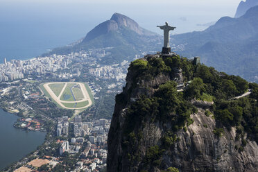 Brazil, Aerial view of Rio De Janeiro, Corcovado mountain with statue of Christ the Redeemer - MAUF000305