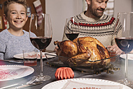 Turkey on table during family's Christmas dinner - MFF002845