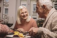 Senior couple having Christmas dinner - MFF002851