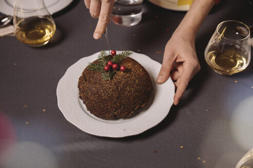 Close-up of Christmas pudding being cut - MFF002863