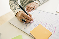 Woman writing on notepad - EBSF001274