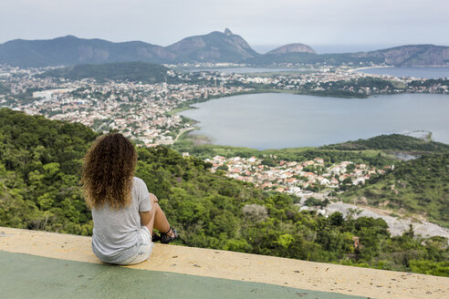 Brazil, woman sitting on a viewpoint in Rio de Janeiro - MAUF000323