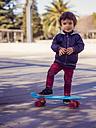 Portrait of little boy with skateboard - XCF000064