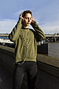 UK, London, female runner listening music at riverwalk - BOYF000130