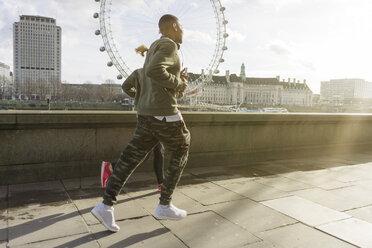 UK, London, man and woman running at riverwalk - BOYF000136