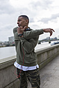UK, London, runner stretching at riverwalk - BOYF000139
