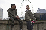 UK, London, two runners talking at riverwalk - BOYF000148
