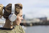 UK, London, woman listening music at River Thames - BOYF000154