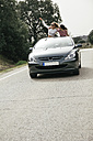 Women having fun in a convertible car on a country road - ABZF000278