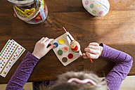 Girl painting Easter egg - SARF002627